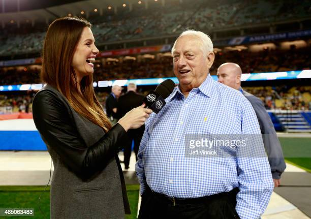 Sportscaster Heidi Androl interviews Tommy Lasorda before the start of the 2014 Coors Light NHL Stadium Series between the Los Angeles Kings and the...