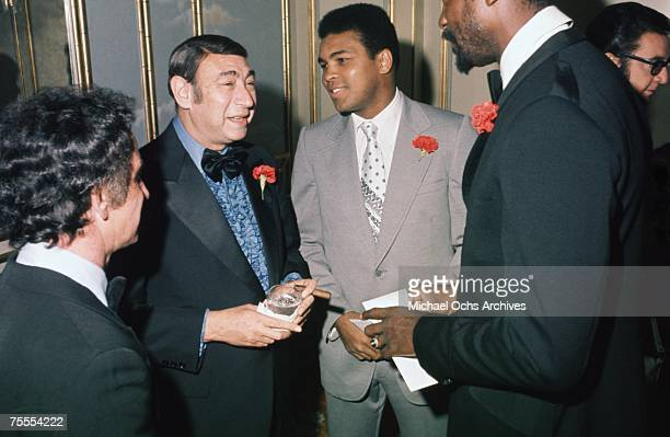 Sportscaster Howard Cosell heavyweight boxer Muhammad Ali and former NBA legend Bill Russell chat at a party circa 1977 in Los Angeles California