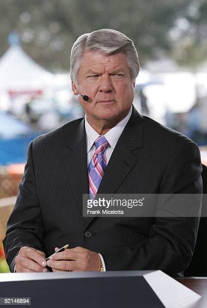 Sportscaster Jimmy Johnson speaks at the FOX Broadcast booth during the XXXIX Superbowl pregame show at Alltel Stadium on February 6 2005 in...
