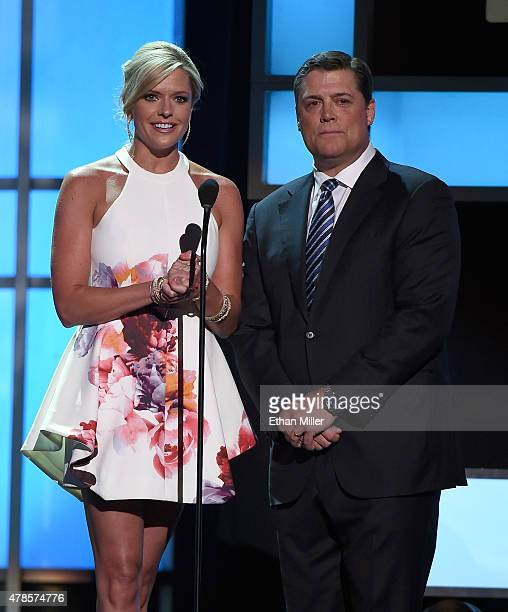 Sportscaster Kathryn Tappen and former NHL player Pat LaFontaine present an award during the 2015 NHL Awards at MGM Grand Garden Arena on June 24...