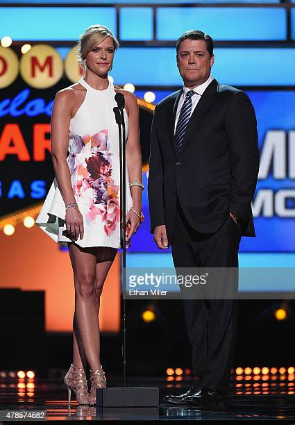 Sportscaster Kathryn Tappen and former NHL player Pat LaFontaine present the James Norris Memorial Trophy during the 2015 NHL Awards at MGM Grand...