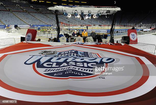 Sportscaster Kathryn Tappen talks with hockey analysts Barry Melrose and Kevin Weekes during NHL Live at the 2014 Bridgestone NHL Winter Classic on...
