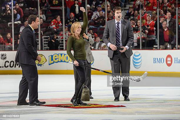 Sportscaster Linda Cohn reacts after making her shot in between periods of the NHL game between the New York Rangers and the Chicago Blackhawks on...