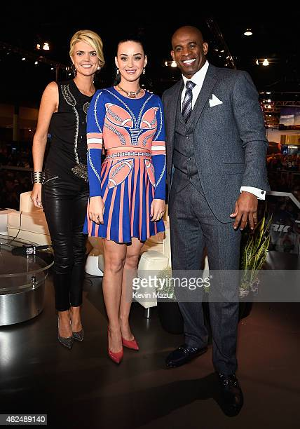 Sportscaster Melissa Stark recording artist Katy Perry and former NFL player and sports analyst Deion Sanders attend the NFL Experience on January 29...