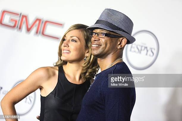 Sportscaster Stuart Scott and guest arrive at ESPN the Magazine's Body Issue 5th annual ESPY's event at Lure on July 16 2013 in Hollywood California