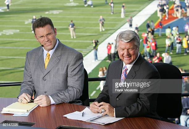 FOX sportscasters Howie Long and Jimmy Johnson speak in the FOX Braodcast booth during the XXXIX Superbowl pregame show at Alltel Stadium on February...