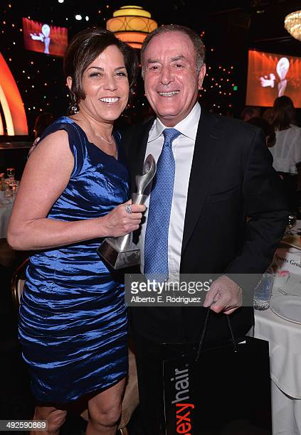 Sportscasters Michele Tafoya and Al Michaels attend the 39th Gracie Awards Gala at The Beverly Hilton Hotel on May 20 2014 in Beverly Hills California