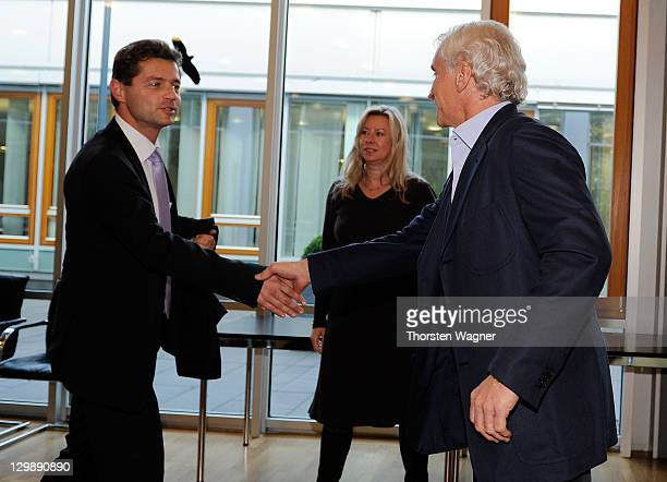 Sportsdirector of Bayer 04 Leverkusen Rudi Voeller shake hands with referee Guenter Perl during the DFB Court Appearance against Rudi Voeller at...