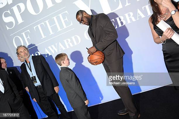 Sportskid Conner Long and 2012 Sportsman of the Year LeBron James attend the 2012 Sports Illustrated Sportsman of the Year award presentation at...