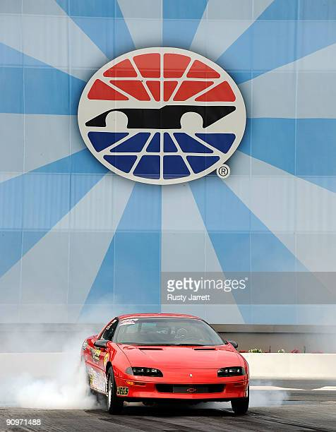 A sportsman class car does a burn out during qualifying for the NHRA Carolinas Nationals on September 19 2009 at Zmax Dragway in Concord North...