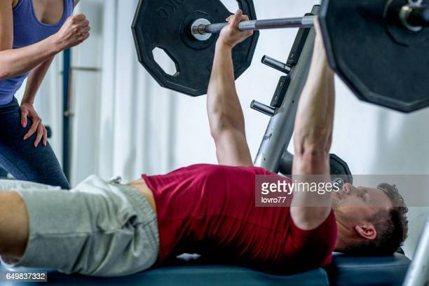 Sportsman doing bench press at the gym.