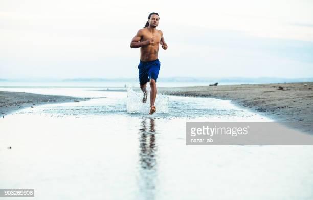 Sportsman doing fitness exercise outdoors.