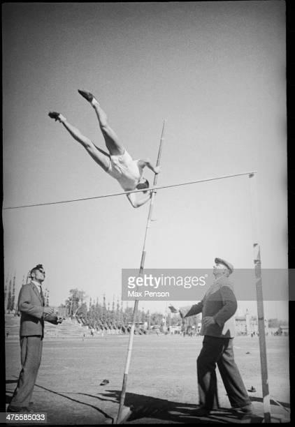 Sportsman during pole vault, 'Spartak' stadium in old city of Tashkent, Uzbekistan, circa 1940.