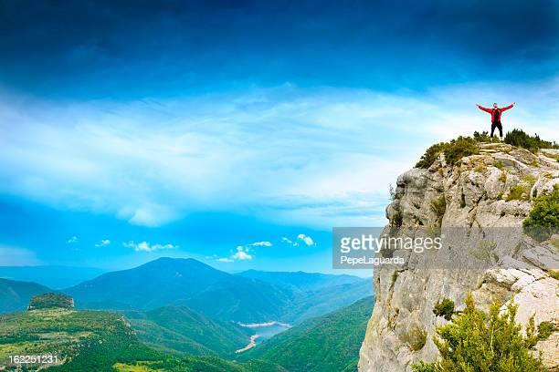Sportsman feeling powerful on a cliff