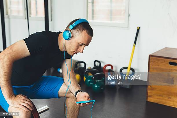 Sportsman in the gym texting