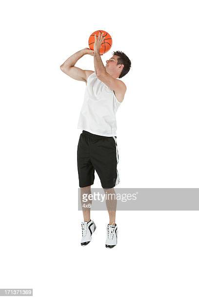 Sportsman jumping with a basketball