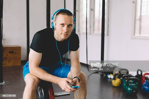 Sportsman listening to the music from smartphone