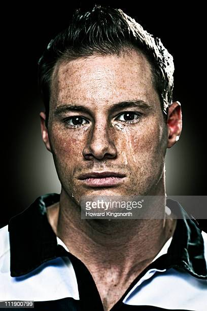sportsman looking to camera, crying