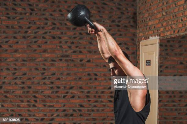 Sportsman performing exercises