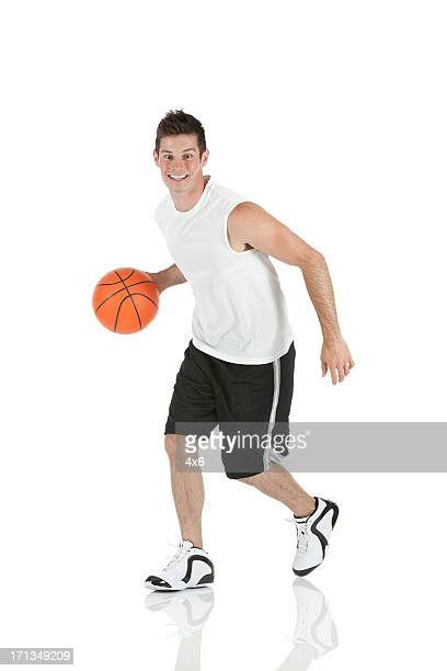 Sportsman playing with a basketball