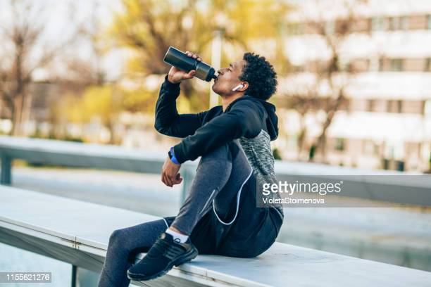 sportsman resting - protein drink stock pictures, royalty-free photos & images