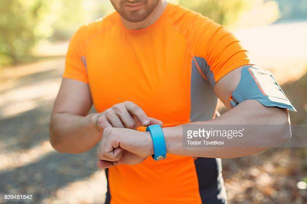 Sportsman using a smart watch