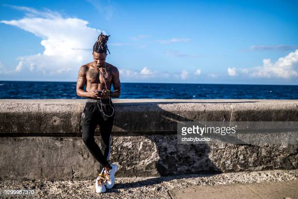 sportsman using smartphone - west indies stock pictures, royalty-free photos & images