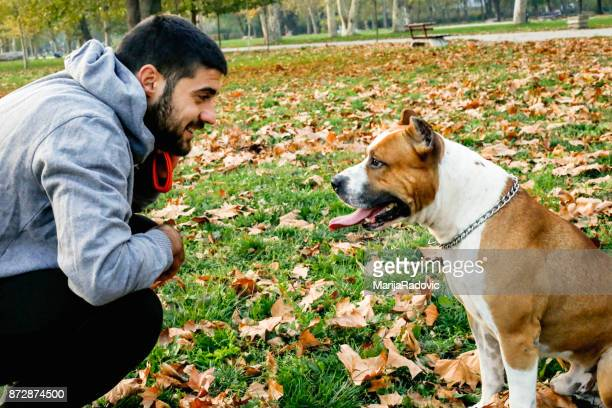 Sportsman with his dog in autumn park
