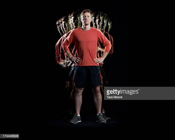 sportsman with multiple strobe - continuità foto e immagini stock