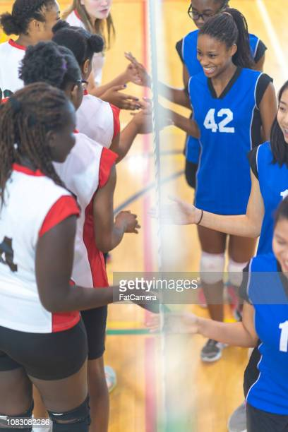 sportsmanship - high school volleyball stock photos and pictures