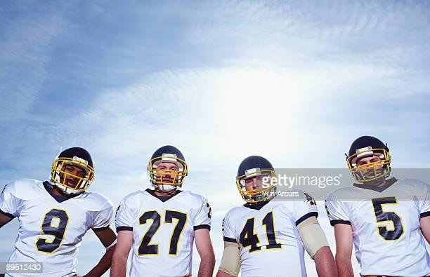 sportsmen standing together  - チームスポーツ ストックフォトと画像