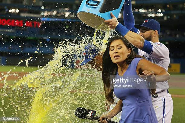 TORONTO ON SEPTEMBER 12 SportsNet reporter Hazel Mae narrowly avoids getting caught in a Powerade shower that Kevin Pillar gave to game hero Ezequiel...