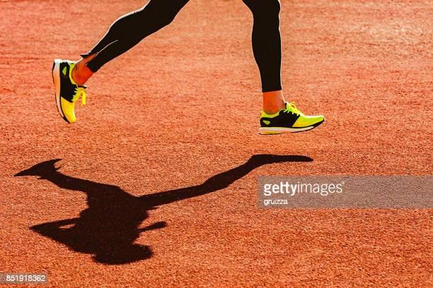Sportsperson running over the running track