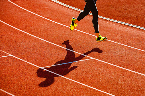 Sportsperson running over the running track - gettyimageskorea