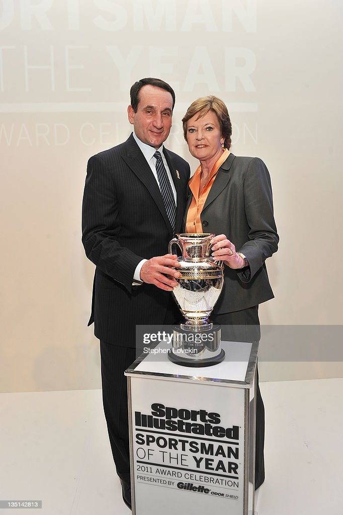 Sportswoman and Sportsman of the Year, College Basketball coaches Pat Summitt and Mike Krzyzewski pose with award at the 2011 Sports Illustrated Sportsman of the Year award presentation at The IAC Building on December 6, 2011 in New York City.