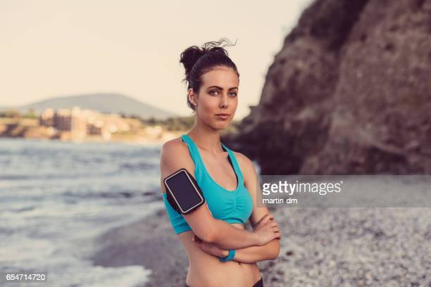 sportswoman at the beach - martin dm stock pictures, royalty-free photos & images