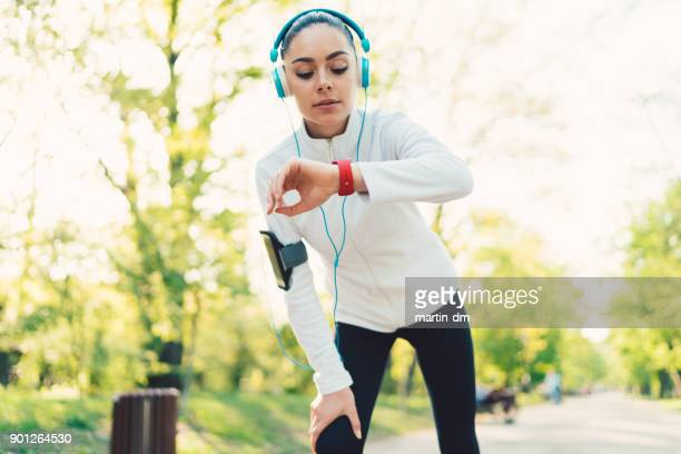 sportswoman checking pulse - fitness tracker stock pictures, royalty-free photos & images