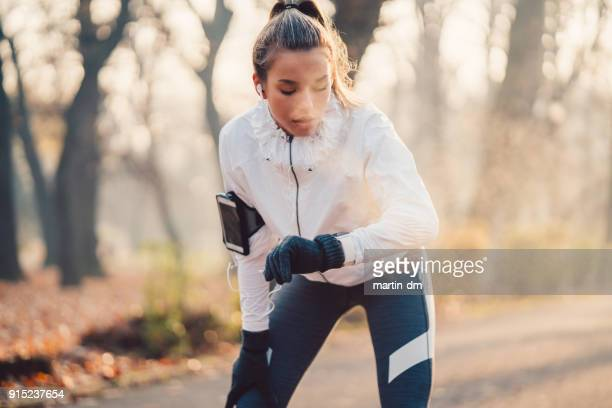 sportswoman checking pulse - running stock pictures, royalty-free photos & images