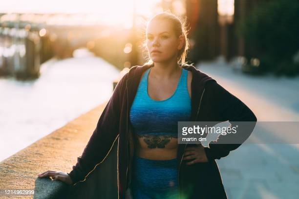 sportswoman determined to get in shape - exercising stock pictures, royalty-free photos & images