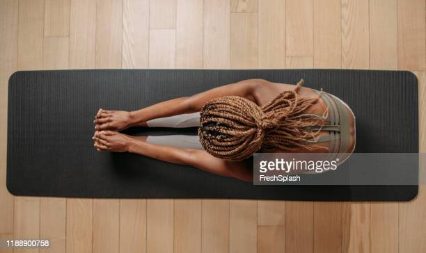 sportswoman doing fitness exercise - pilates stock pictures, royalty-free photos & images
