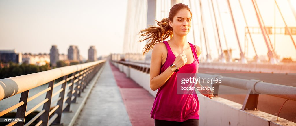 Sportswoman during jogging in the morning : Stock Photo