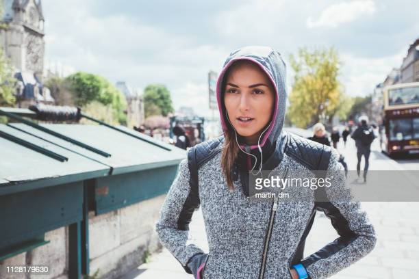 sportswoman in paris - hands in pockets stock pictures, royalty-free photos & images