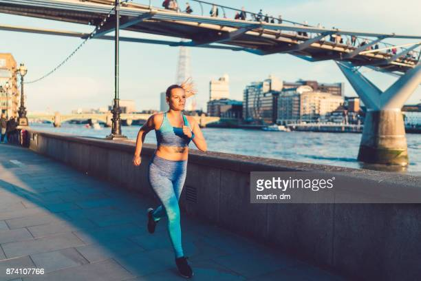 Sportswoman jogging in London