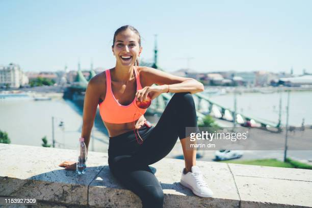 sportswoman jogging in the city - sportswear stock pictures, royalty-free photos & images