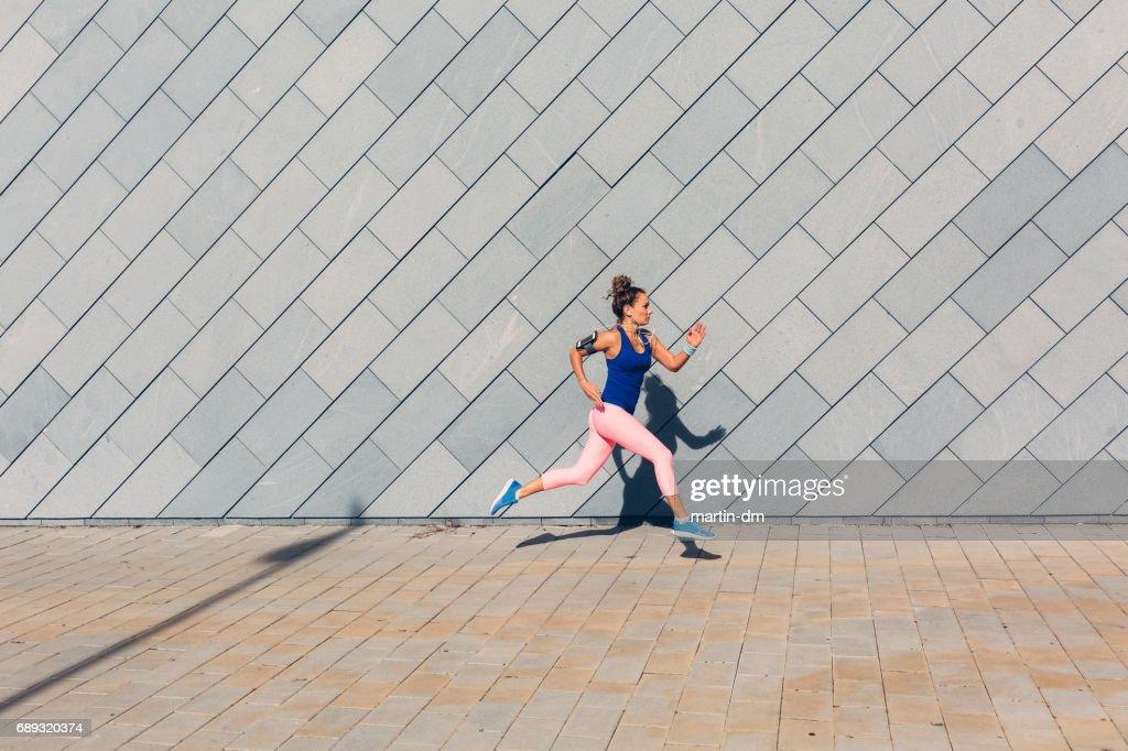 Sportswoman jogging : Stock Photo