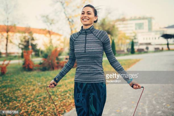 sportswoman jumping rope - skipping rope stock pictures, royalty-free photos & images