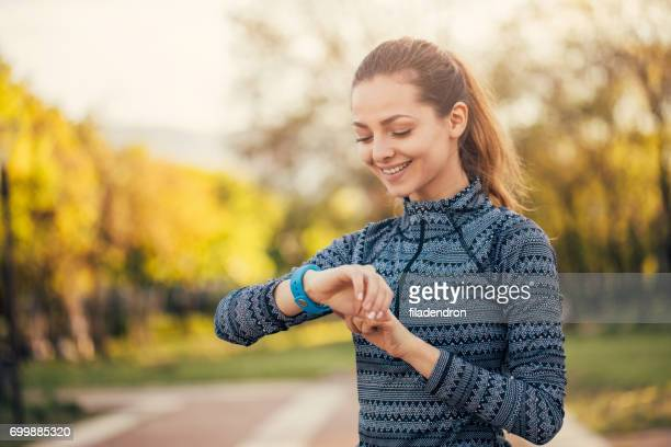 Sportswoman looking at her smart watch