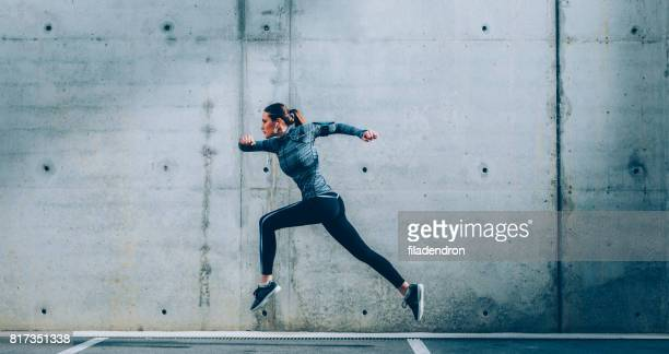 sportswoman - athletics stock photos and pictures