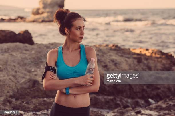 sportswoman resting after workout - martin dm stock pictures, royalty-free photos & images