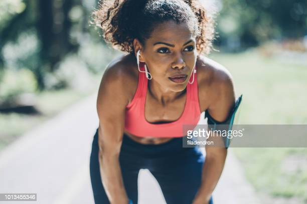 sportswoman resting - concentration stock pictures, royalty-free photos & images